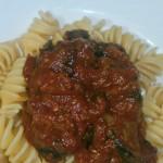 Pasta with eggplant, sauce fruit and salumi
