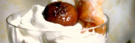 Sweet Roasted chestnuts in syrup and pastry in glass